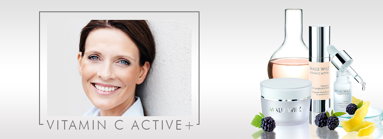 Mature woman with skin care products